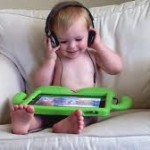 baby with ipad headphones