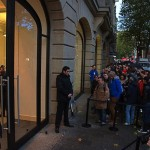Crowds wait outside of an Apple store on November 2, 2012.